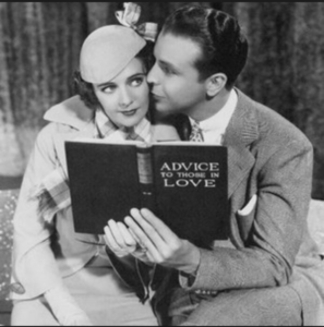Dick Powell with book