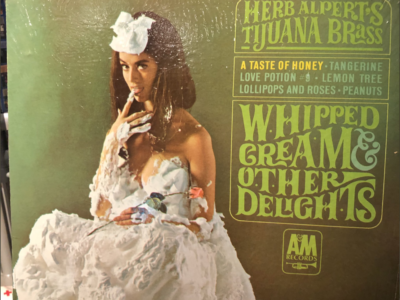 """Herb Alpert's Tijuana Brass - """"Whipped Cream and Other Delights"""" album cover"""